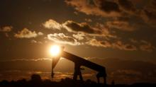 Oil edges up in volatile session but falls for sixth straight week