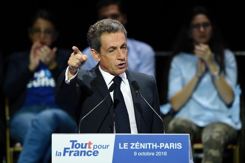Former French President Nicolas Sarkozy delivers a speech during a campaign rally at the Zenith venue, vowing to defend the common man if returned to the top office (AFP Photo/Miguel Medina)