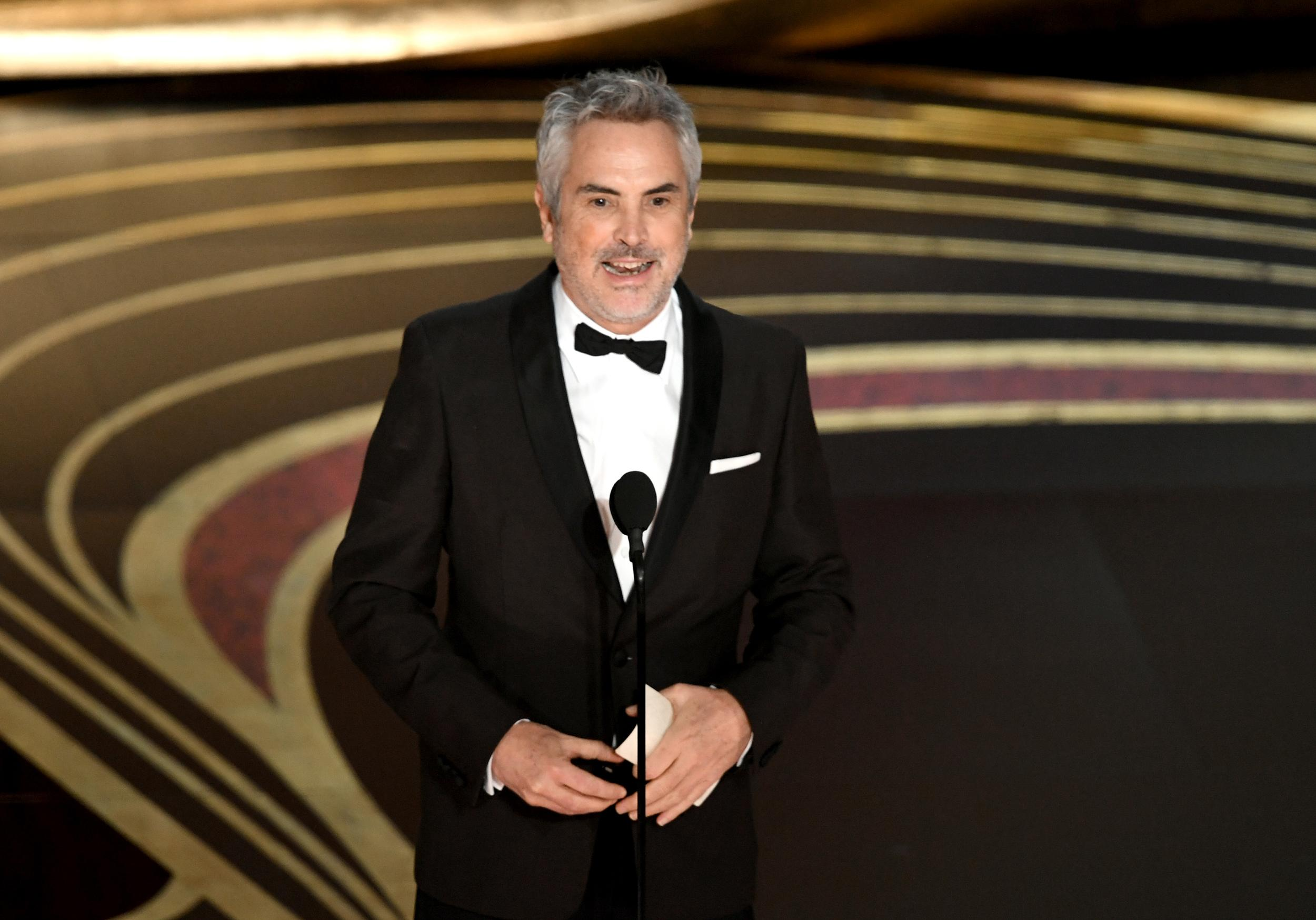HOLLYWOOD, CALIFORNIA - FEBRUARY 24: Alfonso Cuaron accepts the Best Director award for 'Roma' onstage during the 91st Annual Academy Awards at Dolby Theatre on February 24, 2019 in Hollywood, California. (Photo by Kevin Winter/Getty Images)