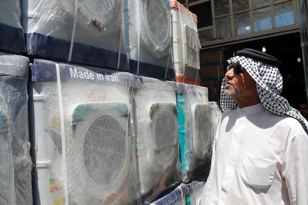 Iraq's economy is profoundly intertwined with that of Iran, and its markets are flooded with Iranian goods like these washing machines seen at a Baghdad store on August 6, 2018 (AFP Photo/SABAH ARAR)