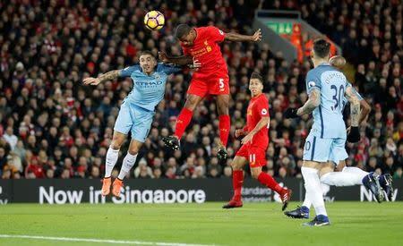 Britain Football Soccer - Liverpool v Manchester City - Premier League - Anfield - 31/12/16 Liverpool's Georginio Wijnaldum scores their first goal Action Images via Reuters / Carl Recine Livepic