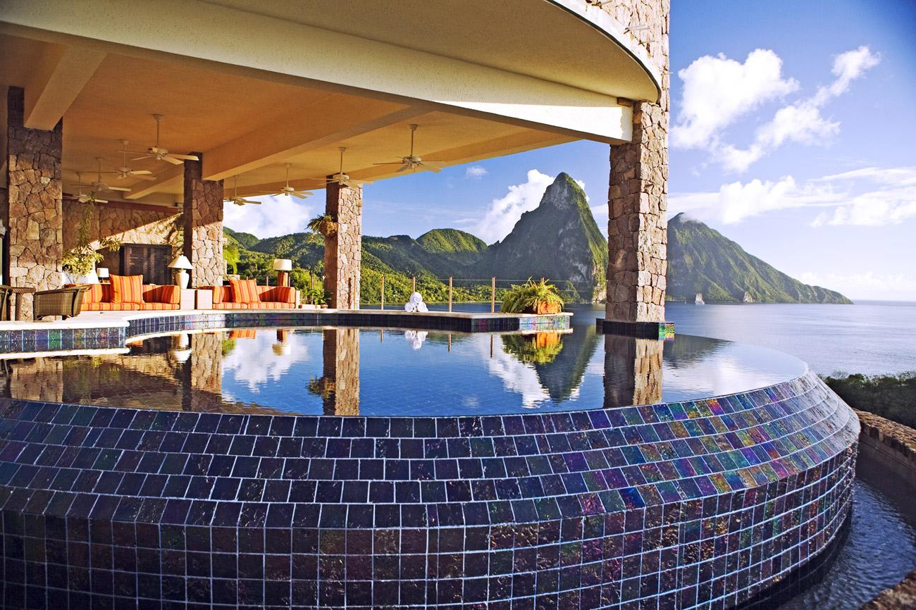 """Say I love you by booking a trip to <b><a href=""""http://www.jademountain.com/"""" target=""""_blank"""">Jade Mountain</a></b> on the Caribbean island of St Lucia. Hole up at this exclusive resort and you'll find they've thought of everything to make your honeymoon unforgettable and wrapped it up in a package appropriately entitled """"Total Romance"""". Treats range from spa treatments to jungle biking, there's even a scuba diving course for beginners thrown in. But this very special honeymoon doesn't come cheap – expect to shell out $12,116 for two for seven nights."""