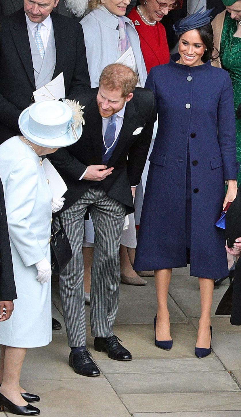 Britain's Queen Elizabeth II (L) talks with Britain's Prince Harry, Duke of Sussex, and Meghan, Duchess of Sussex after the wedding of Britain's Princess Eugenie of York to Jack Brooksbank at St George's Chapel, Windsor Castle, in Windsor, on October 12, 2018. (Photo by Aaron Chown / POOL / AFP)        (Photo credit should read AARON CHOWN/AFP/Getty Images)