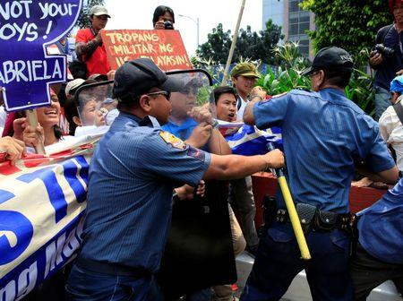 Anti-riot policemen block protesters denouncing the visit of U.S. Secretary of State John Kerry and the Supreme Court's decision to uphold, with finality, the constitutionality of the Enhanced Defense Cooperation Agreement (EDCA) during a protest outside the U.S. embassy in metro Manila, Philippines July 27, 2016. REUTERS/Romeo Ranoco