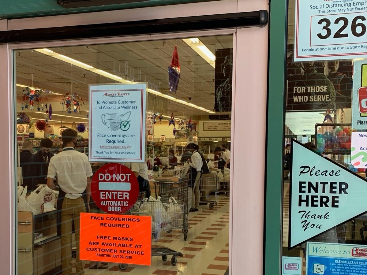 Notices on the doors of Market Basket locations in Concord tell customers that face coverings or masks will be required of everyone being July 20.