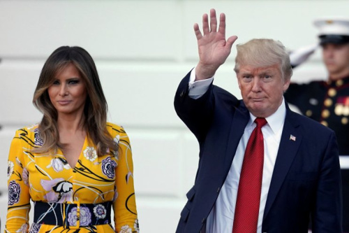 Melania Trump and President Trump wave as Prime Minister Narendra Modi of India leaves the White House.