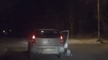 Baby falls out of moving car into middle of road in Russia