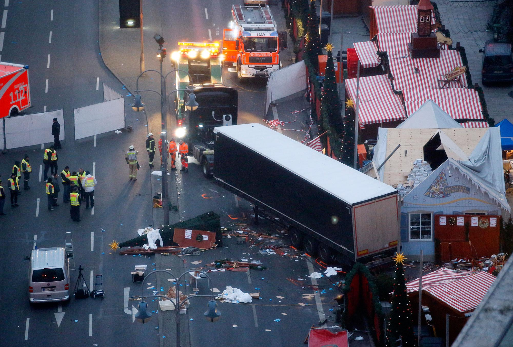 <p>A tow truck operates at the scene where a truck ploughed through a crowd at a Christmas market on Breitscheidplatz square near the fashionable Kurfuerstendamm avenue in the west of Berlin, Germany on Dec. 20, 2016. (Fabrizio Bensch/Reuters) </p>