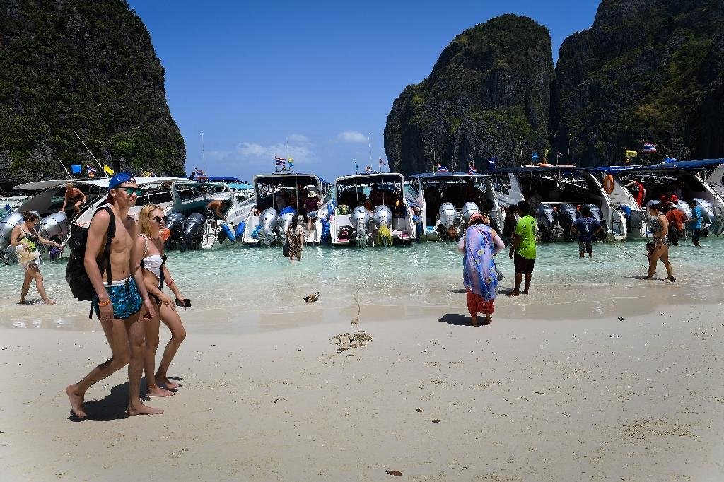 Countries across the region from the Philippines to Indonesia are waking up to the problem of beach tourism overload and the plastic waste and degradation that can come with it (AFP Photo/Lillian SUWANRUMPHA)