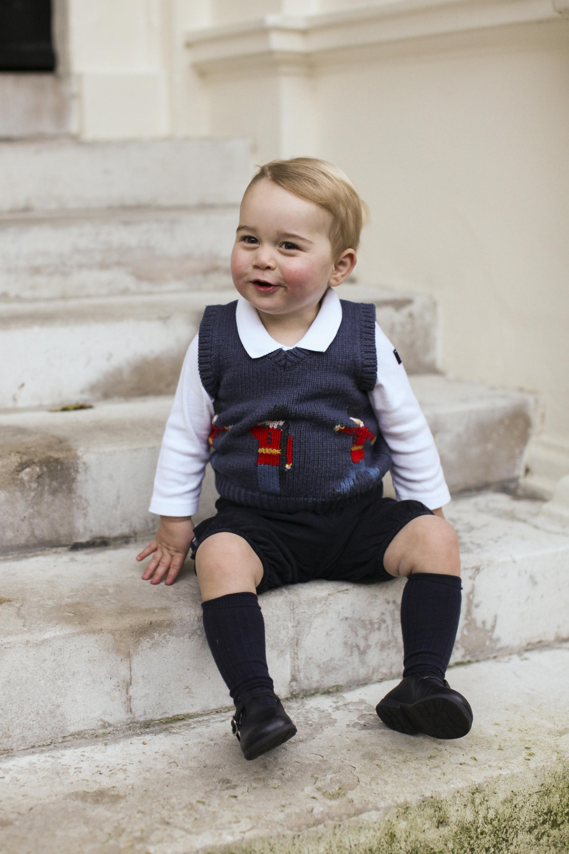 Britain's Prince George poses in a courtyard at Kensington Palace in London in this one out of three official Christmas photographs of him taken in late November and released on December 13, 2014. REUTERS/TRH The Duke and Duchess of Cambridge/Handout via Reuters (BRITAIN - Tags: ROYALS ENTERTAINMENT SOCIETY TPX IMAGES OF THE DAY) ATTENTION EDITORS - THIS PICTURE WAS PROVIDED BY A THIRD PARTY. REUTERS IS UNABLE TO INDEPENDENTLY VERIFY THE AUTHENTICITY, CONTENT, LOCATION OR DATE OF THIS IMAGE. FOR EDITORIAL USE ONLY. NOT FOR SALE FOR MARKETING OR ADVERTISING CAMPAIGNS. THIS PICTURE IS DISTRIBUTED EXACTLY AS RECEIVED BY REUTERS, AS A SERVICE TO CLIENTS. NO SALES. NO ARCHIVES