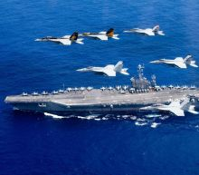 US Navy chief hints aircraft carrier could be sent through Taiwan Strait, despite threat of new Chinese missiles