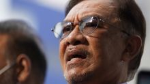 Malaysia's Anwar grilled by police over bid to become PM