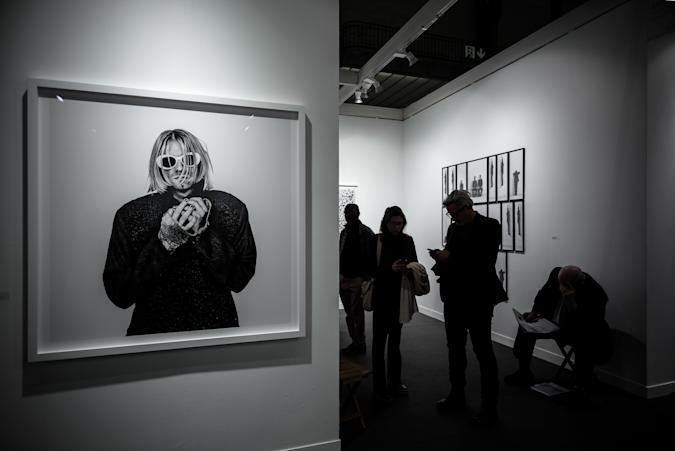 Visitors stand next to a photograph of late US singer Kurt Cobain by Dutch photographer Anton Corbijn during the opening of the 20th edition of Paris photo, the international fine art photography fair at the Grand Palais in Paris on November 9, 2016.  The fair runs from November 10 to 13, 2016.   / AFP / PHILIPPE LOPEZ / RESTRICTED TO EDITORIAL USE - MANDATORY MENTION OF THE ARTIST UPON PUBLICATION - TO ILLUSTRATE THE EVENT AS SPECIFIED IN THE CAPTION        (Photo credit should read PHILIPPE LOPEZ/AFP/Getty Images)