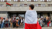 Belarus jails two opposition leaders; teachers head rally of thousands