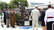 Who is the British-Fijian war hero depicted in the statue unveiled by Prince Harry and Meghan Markle?
