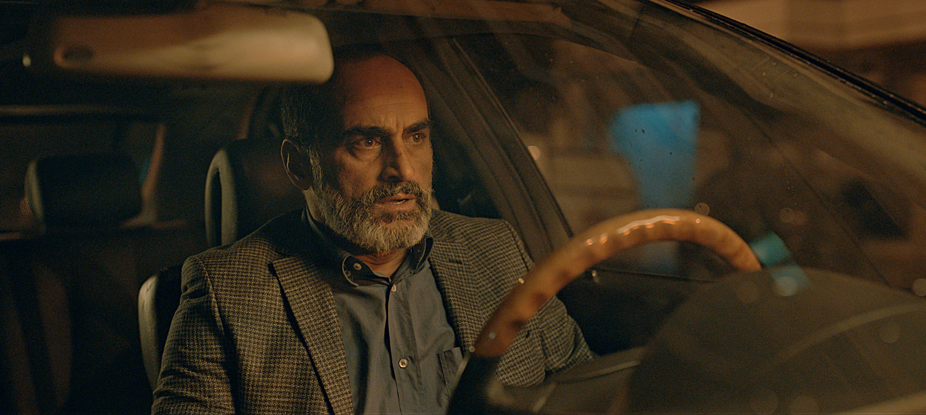 """This image released by Apple TV+ shows Navid Negahban as Masoud Tabrizi in a scene from """"Tehran."""" (Apple TV+ via AP)"""
