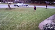 Police officer pulls over to play catch with a boy who was alone