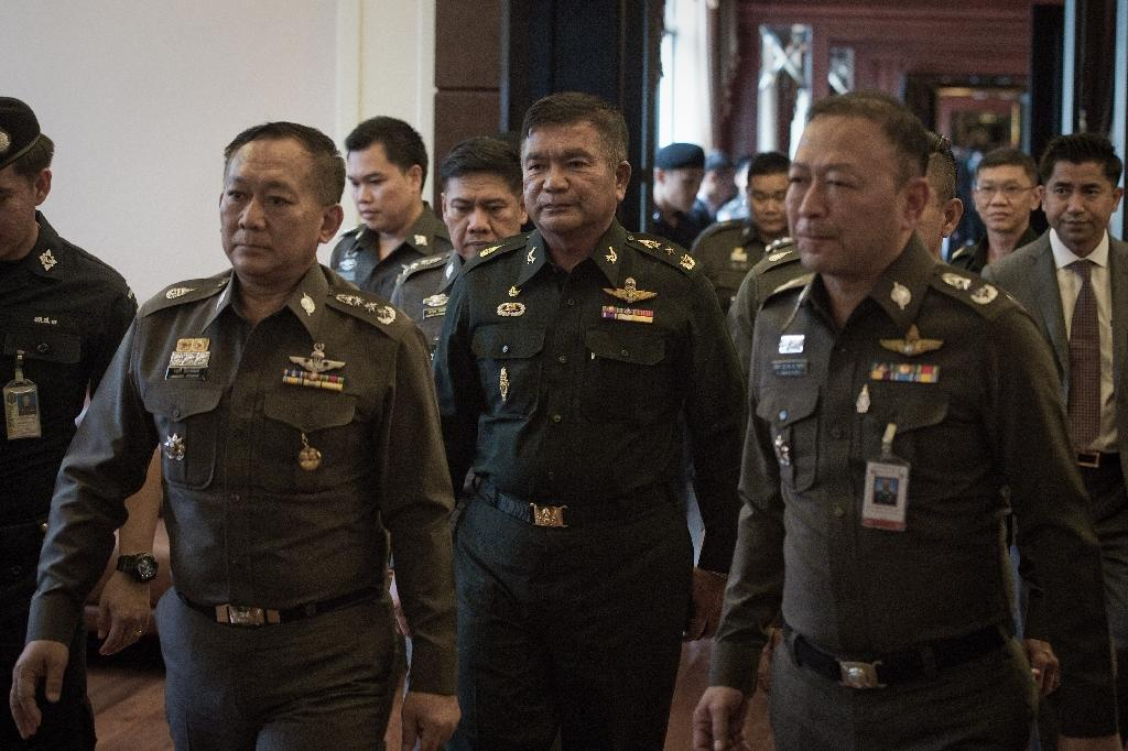 Thai army officer wanted for migrant trafficking surrenders