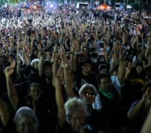 Thousands camp outside Thai PM's office as protests escalate