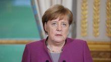 Merkel defends German trade surplus, says trying to boost domestic demand