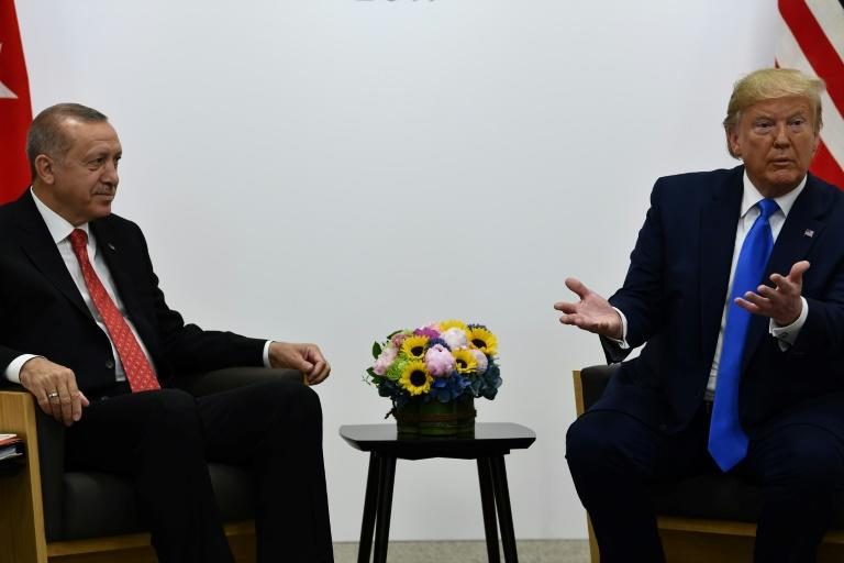 Even before entering office, Trump and Erdogan, pictured together at the 2019 G20 summit in Osaka, enjoyed cordial ties (AFP Photo/Brendan Smialowski)