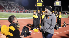 High school cheerleaders go off-script to help man propose to their coach