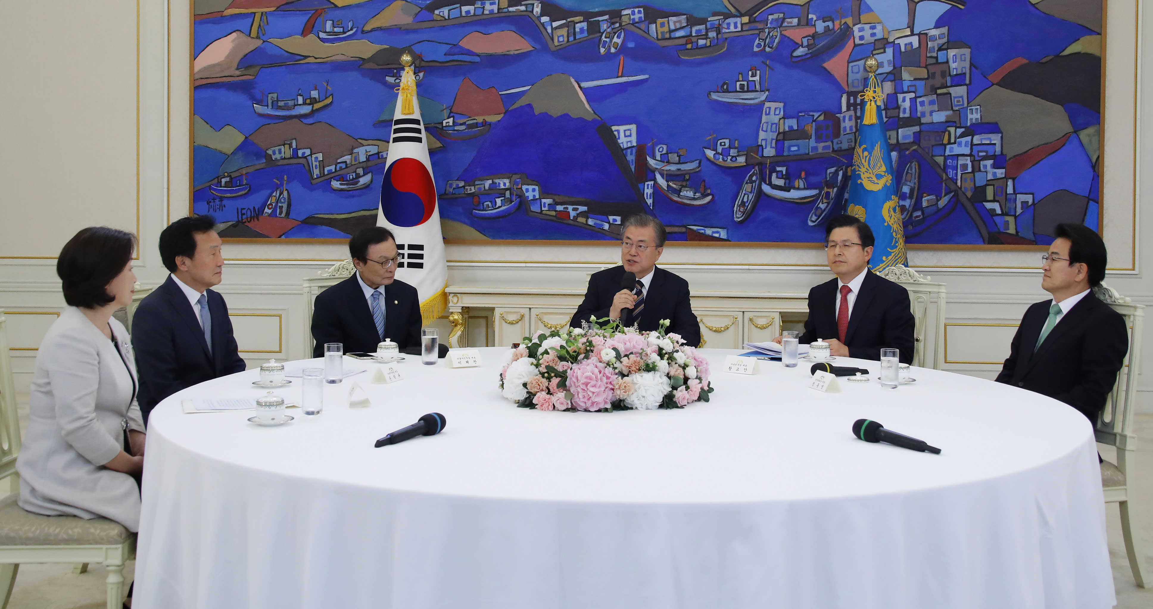 South Korean President Moon Jae-in, third from right, speaks during a meeting with ruling and opposition party leaders to talk about an ongoing South Korea-Japan trade conflict at the presidential Blue House in Seoul, South Korea, Thursday, July 18, 2019. (Bee Jae-man/Yonhap via AP)