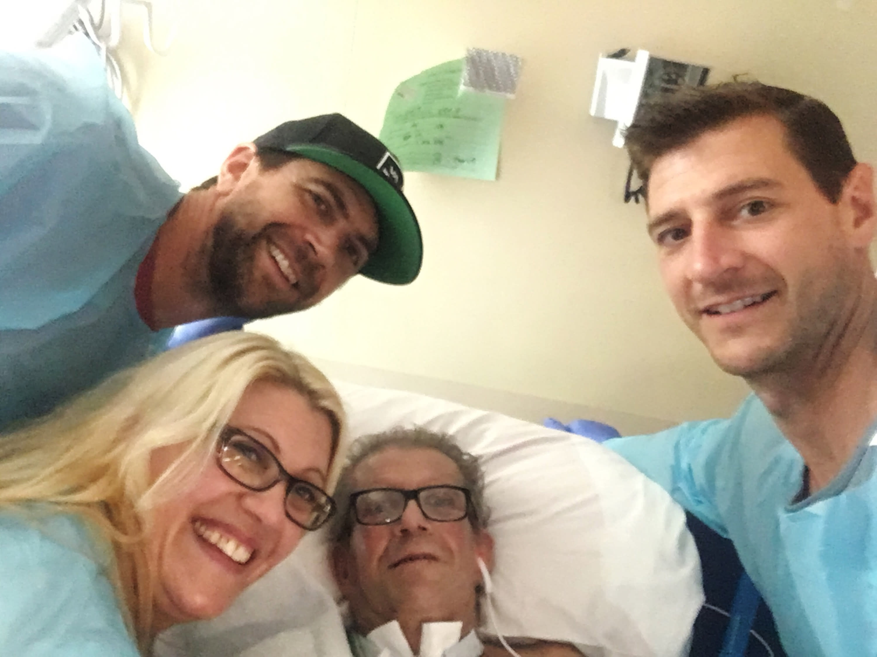 This June 16, 2019, photo provided by Jessee Ernest shows his father Paul Ernest, center, surrounded by family members at Vibra Hospital in Folsom, Calif. Ernest is joined by his sons Jessee, top left, Jake and his daughter, Arielle. Paul Ernest, who had been hospitalized since the deadliest wildfire in California history incinerated a town in November has died, raising the number of people killed to 86, authorities said Thursday, Aug. 8. (Jessee Ernest via AP)
