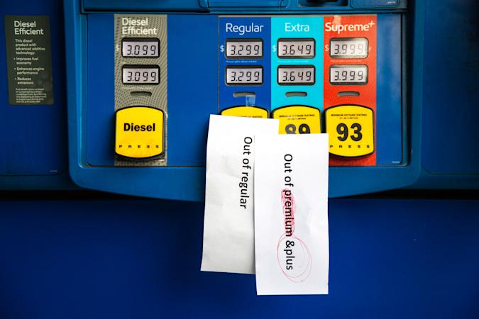 Notes are left on gas pumps to let motorists know the pumps are empty at an Exxon gas station in Charlotte, North Carolina on May 12, 2021. - Fears the shutdown of the Colonial Pipeline because of a cyberattack would cause a gasoline shortage led to some panic buying and prompted US regulators on May 11, 2021 to temporarily suspend clean fuel requirements in three eastern states and the nation's capital. (Photo by Logan Cyrus / AFP) (Photo by LOGAN CYRUS/AFP via Getty Images)