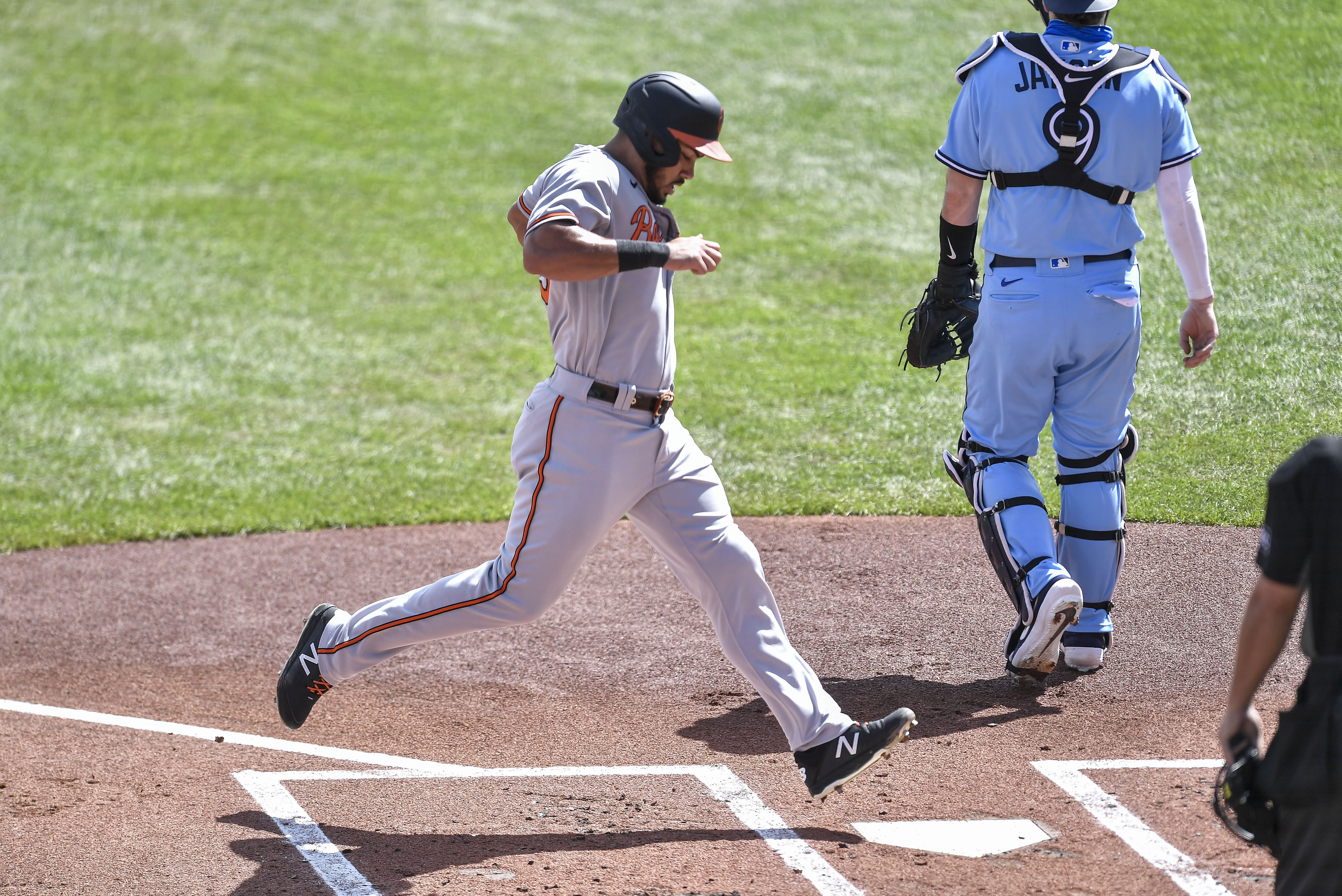 Baltimore Orioles' Anthony Santander scores against the Toronto Blue Jays on a single by José Iglesias during the first inning of a baseball game in Buffalo, N.Y., Monday, Aug. 31, 2020. (AP Photo/Adrian Kraus)