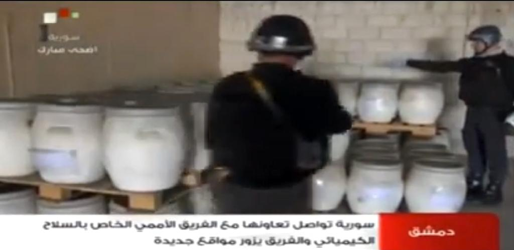 An image grab from Syrian television on October 19, 2013 shows inspectors from the Organisation for the Prohibition of Chemical Weapons at work in an undisclosed location in Syria (AFP Photo/)
