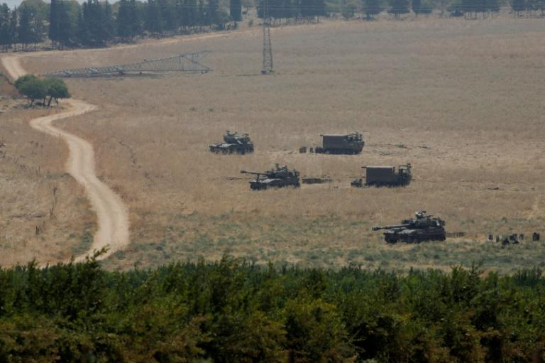 Armoured vehicles and 155 mm self-propelled howitzers are deployed in the Upper Galilee in northern Israel on the border with Lebanon on July 27 (AFP Photo/JALAA MAREY)