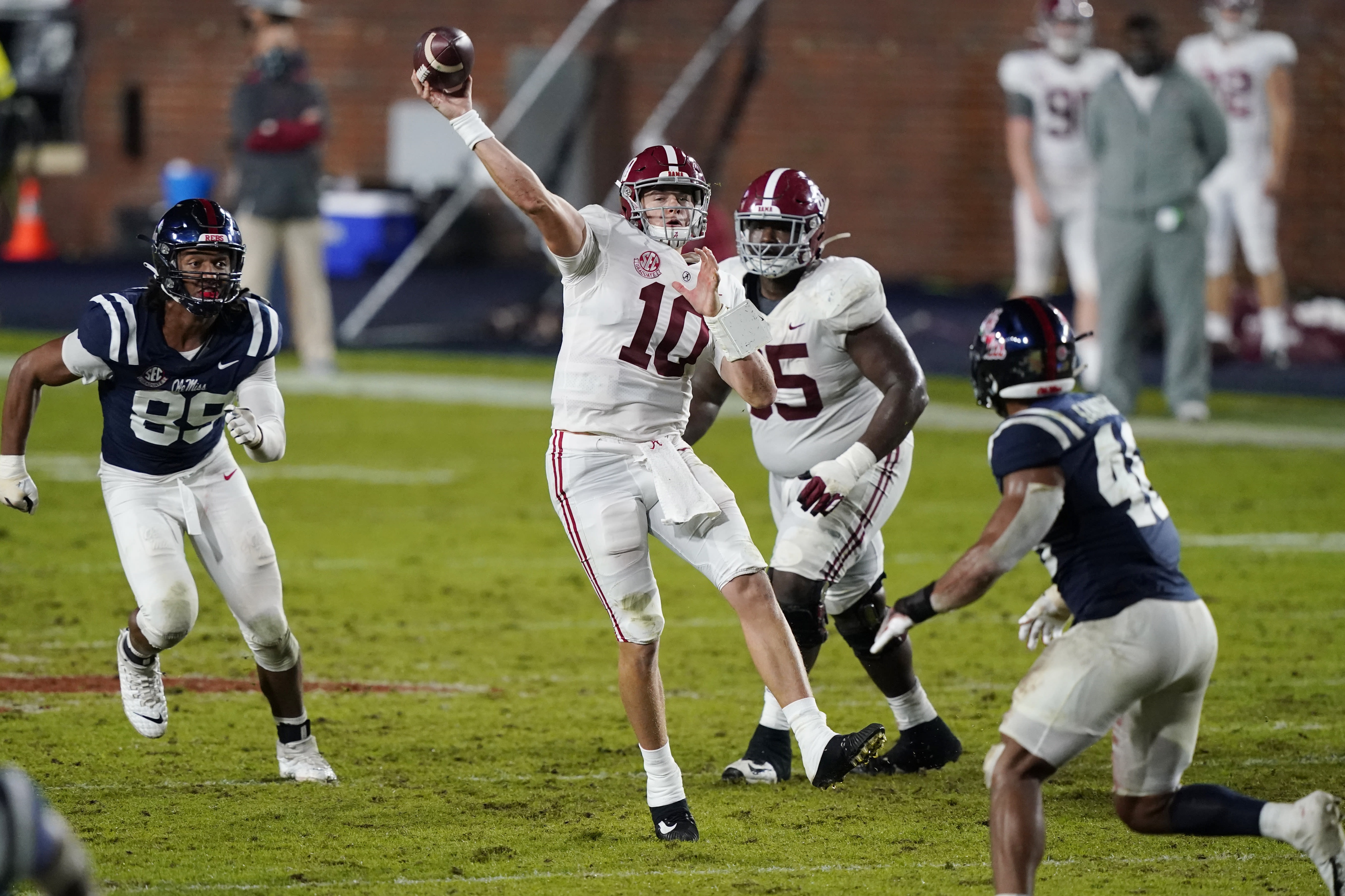 Alabama quarterback Mac Jones (10) passes while being pursued by Mississippi defensive end Ryder Anderson (89) during the second half of an NCAA college football game in Oxford, Miss., Saturday, Oct. 10, 2020. Alabama won 63-48. (AP Photo/Rogelio V. Solis)