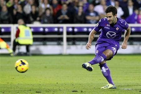 Fiorentina's Rossi scores a penalty against Napoli during their Italian Serie A soccer match in Florence