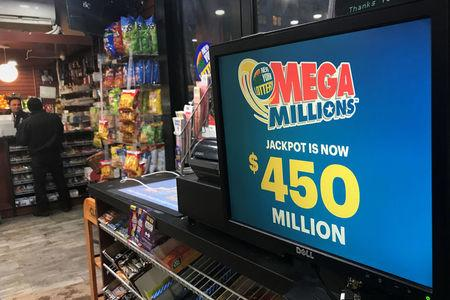 A Mega Millions sign is pictured in a store in New York City, New York, U.S., January 5, 2018. REUTERS/Carlo Allegri