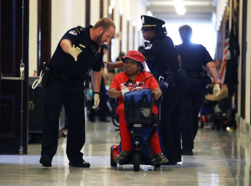 U.S. Capitol Police remove protesters from in front of the office of Senate Majority Leader Mitch McConnell inside the Russell Senate Office Building on Capitol Hill. (Photo: Mark Wilson/Getty Images)