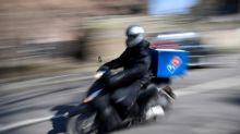 UK's Domino's Pizza profit slips as virus dents orders, adds costs