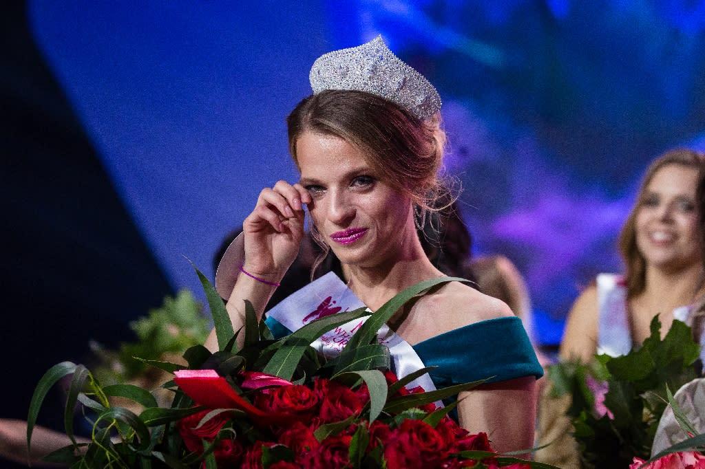Miss Belarus Aleksandra Chichikova reacts after winning the Miss Wheelchair World title, the first contest of its kind on a global scale. (AFP Photo/Wojtek Radwanski)