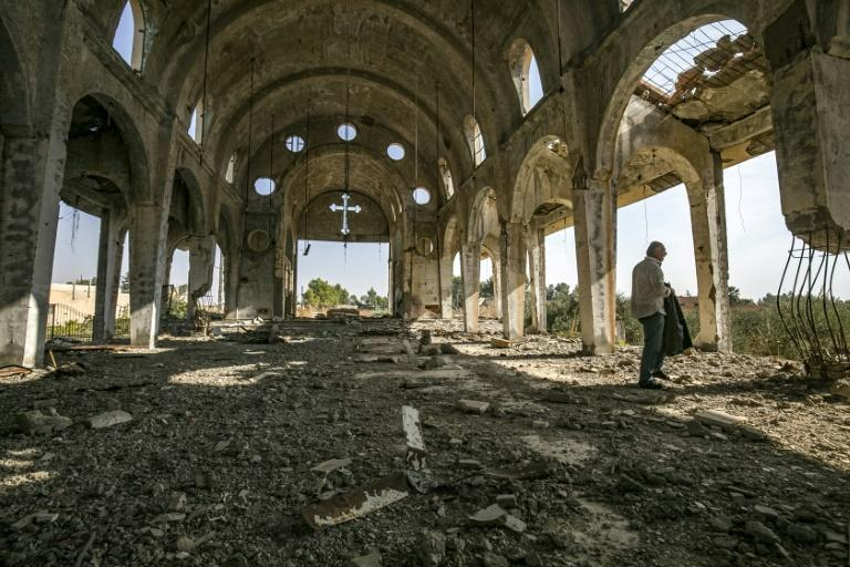The church of the Virgin Mary in the Assyrian village of Tal Nasri was destroyed by the Islamic State group in 2015 (AFP Photo/Delil souleiman)