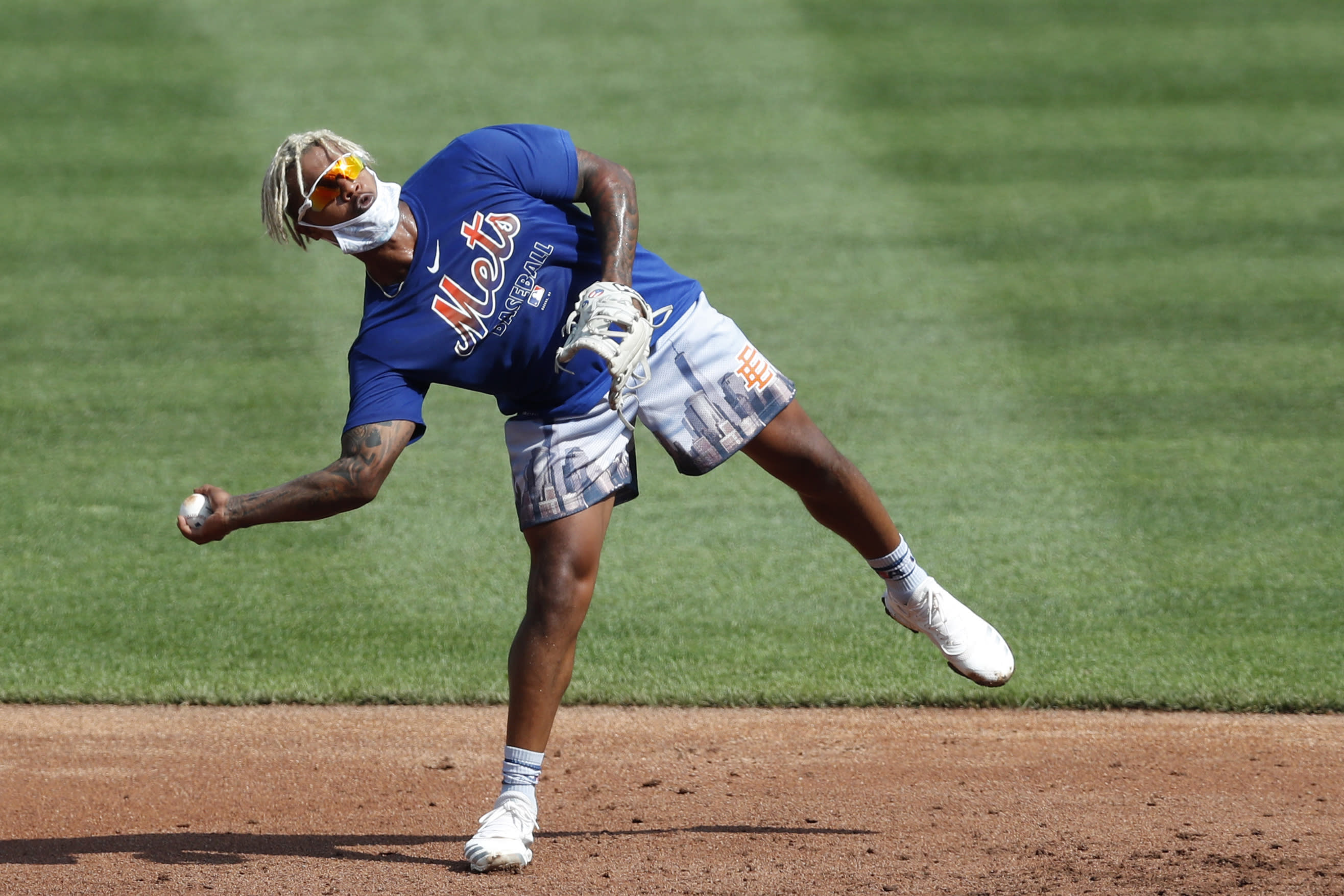 New York Mets starting pitcher Marcus Stroman throws from one leg during fielding drills at a summer baseball training camp workout at CitiField, Thursday, July 9, 2020, in New York. (AP Photo/Kathy Willens)