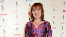 Lorraine Kelly screams in terror as clown gatecrashes her show