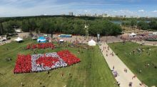 Living Canadian flag comes to life in Regina