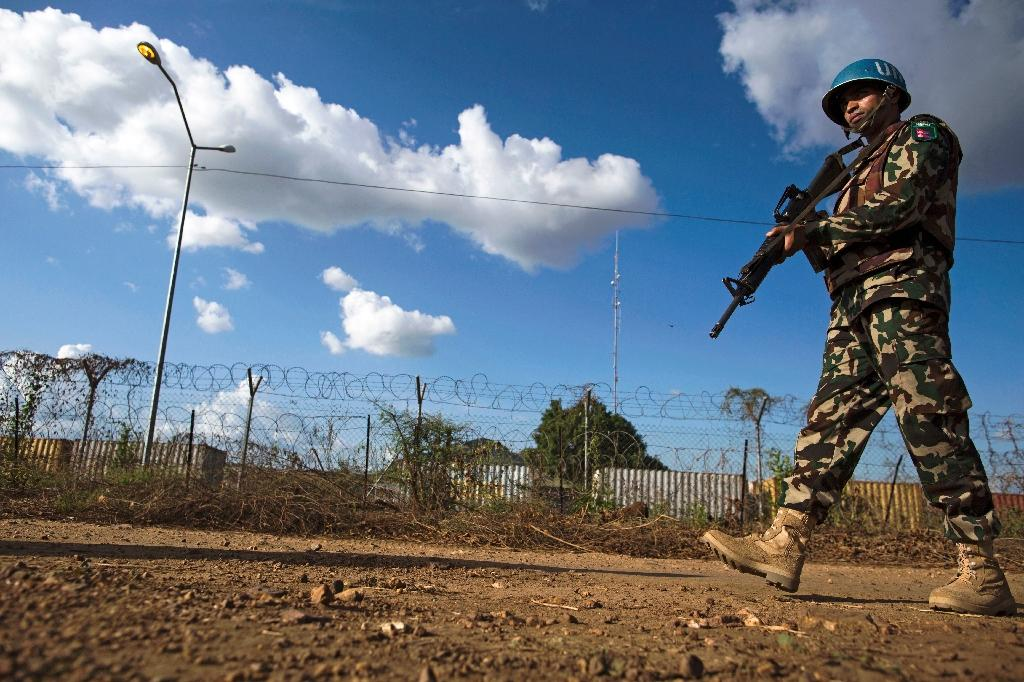 A Nepalese peacekeeper patrols outside the UN Protection of Civilians (PoC) site in Juba, South Sudan (AFP Photo/ALBERT GONZALEZ FARRAN)