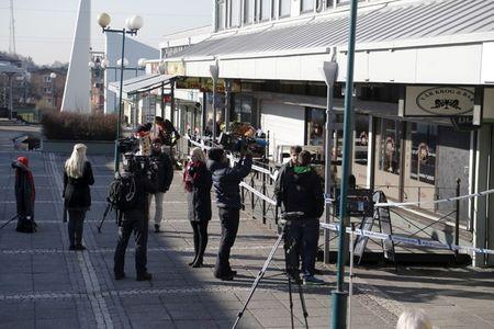 FILE PHOTO: Members of the media work at the scene of a fatal shooting in Gothenburg, Sweden March 18, 2015. Several people were killed in the restaurant shooting in the Swedish city of Gothenburg on Wednesday in what police say was likely to be a gang-related shooting. REUTERS/Adam Ihse/TT News Agency/File Photo