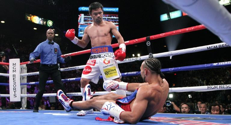 Pacquiao, Mayweather Spar On Social Media After Keith Thurman Fight