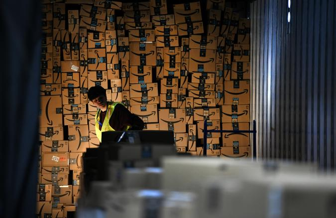 THORNTON, CO - FEBRUARY 19: Jared Villarreal loads boxes into a trailer of a truck to be shipped out at Amazon's Fulfillment Center on March 19, 2019 in Thornton, Colorado. The facility which opened in July of 2018 is 855,000 square feet, and employees over 1500 people. The Thornton facility is a state-of-the-art facility that uses Amazon Robotics to move the merchandise around from one area to the next.  Hundreds of workers perform a variety of jobs in the huge facility. Many workers stand at stations, picking items to ship from trays brought to them by robots that roam the massive warehouse floor. The robotic facility, near I-25 and 144th Avenue, distributes small- and medium-sized items and  allows for quicker delivery of orders in the metro area.  (Photo by Helen H. Richardson/MediaNews Group/The Denver Post via Getty Images)