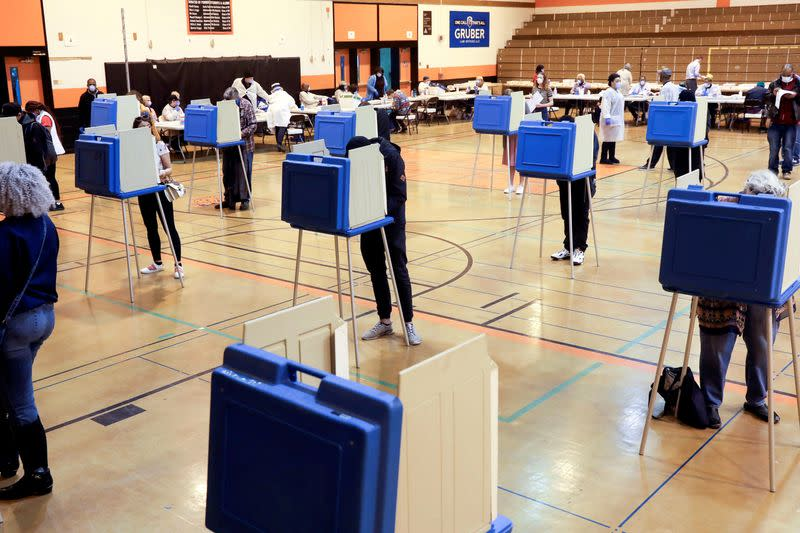 FILE PHOTO: Voters cast ballots during the presidential primary election in Wisconsin