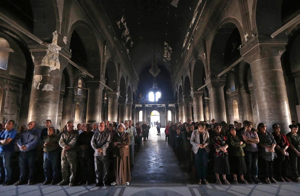 Iraqi Christians attend a mass at the Church of the Immaculate Conception in the predominantly Christian Iraqi town of Qaraqosh on July 24, 2017