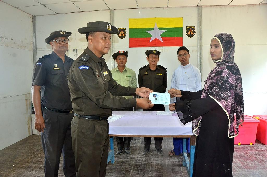 """A family of five was """"repatriated"""" by Myanmar from a wedge of no-man's land between Myanmar and Bangladesh, but it was pilloried as a PR stunt by rights groups and labelled """"not meaningful"""" by Bangladesh's home minister (AFP Photo/Myanmar News Agency)"""