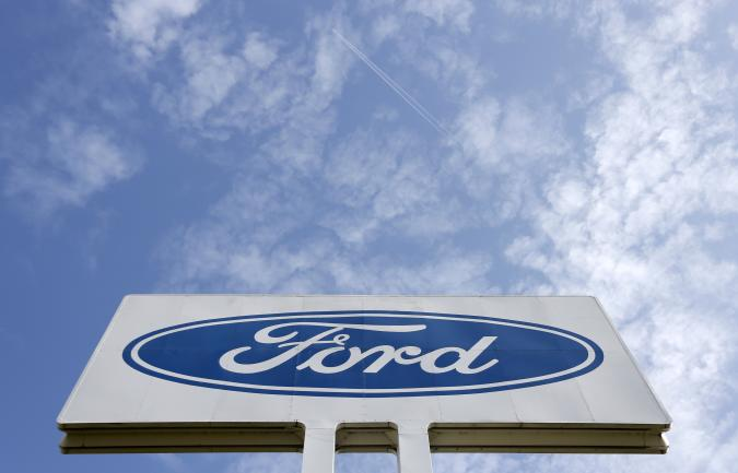 The logo of Ford Motor Co is seen at the company's assembly plant after an emergency meeting with the plant management in Genk October 24, 2012. Ford Motor Co announced to unions on Wednesday that it will close the factory employing 4,300 workers in the Belgian town of Genk, as it tries to stem losses in Europe and match capacity to tumbling demand. REUTERS/Francois Lenoir (BELGIUM - Tags: TRANSPORT BUSINESS EMPLOYMENT LOGO)